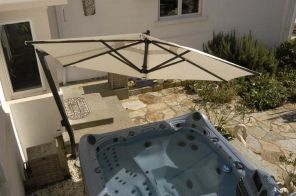 C05 - 10½' Hexagonal Cantilever with Spa by FIM